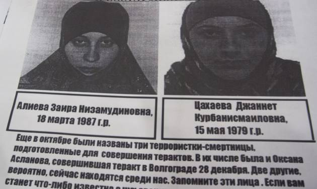"""A photo of a police leaflet seen in a Sochi hotel on Tuesday, Jan. 21, 2014, depicting Dzhannet Tsakhayeva, right, and Zaira Aliyeva. Russian security officials are hunting down three potential female suicide bombers, one of whom is believed to be in Sochi, where the Winter Olympics will begin next month. Police leaflets seen by an Associated Press reporter at a central Sochi hotel on Tuesday contain warnings about three potential suicide bombers. The police leaflet reads: """"Please remember those faces, terrorists may be among us now. If you happen to know anything about them please call 02...."""". (AP Photo/Natalya Vasilyeva)"""