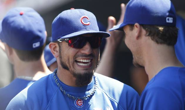 Chicago Cubs pitcher Matt Garza, left, jokes with outfielder Cole Gillespie before facing the Colorado Rockies in a baseball game in Denver, Sunday, July 21, 2013. (AP Photo/David Zalubowski)
