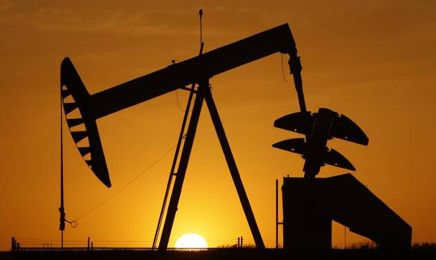 FILE - In this March 22, 2012 file photo, a pumpjack is silhouetted against the setting sun in Oklahoma City. On June 2, 2014, Oklahoma Attorney General Scott Pruitt said an Environmental Protection Agency plan to limit greenhouse gas emissions from power plants hampers the ability of states to devise their own ways to make the cuts. The plan suggests a 35 percent reduction of carbon emissions in Oklahoma by 2030. The state derives more than half its energy from natural gas and roughly 38 percent from coal. (AP Photo/Sue Ogrocki, File)