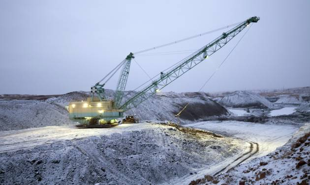 FILE - In this undated file photo provided by Ambre Energy, a dragline moves earth at the Decker Coal Mine in Decker, Mont. Court documents show Cloud Peak Energy and Australia-based Ambre Energy are renegotiating the terms of a deal that called for Ambre to pay $57 million for full control of the Decker mine near the Wyoming border. (AP Photo/Ambre Energy, Laszlo Bencze, File)