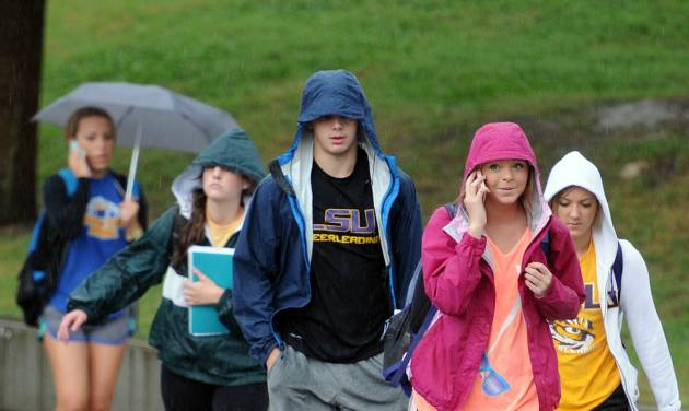 Students, faculty and staff evacuate LSU's main campus in Baton Rouge, La., Monday, Sept. 17, 2012 after an emergency text message was sent out. Thousands of students, professors and workers were evacuated from Louisiana State University's main campus Monday following a bomb threat, school officials said. (AP Photo/The Daily Reveille, Catherine Threlkeld)