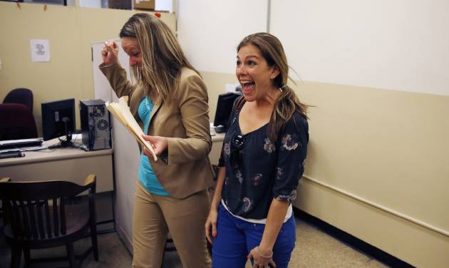 Ashley Wilson, left, and Lindsay Vandermay, right, both 29, react after getting their marriage license at the Philadelphia Marriage Bureau in City Hall, Tuesday, May 20, 2014, in Philadelphia. Pennsylvania's ban on gay marriage was overturned by a federal judge Tuesday. (AP Photo/Matt Slocum)