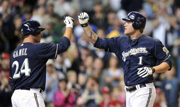 Milwaukee Brewers' Mat Gamel (24) congratulates Corey Hart (1) after Hart's solo home run against the St. Louis Cardinals during the fifth inning of a baseball game, Sunday, April 8, 2012, in Milwaukee. (AP Photo/Jim Prisching)