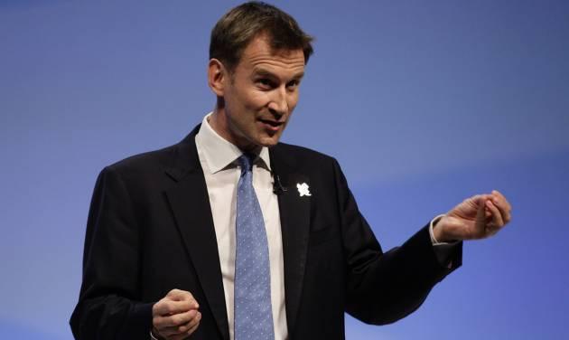 FILE - In this Monday Oct. 3, 2011 file photo Jeremy Hunt, Secretary of Sate for Culture, Olympics, Media and Sport, speaks at Britain's Conservative Party Conference in Manchester, England. (AP Photo/Jon Super, file)