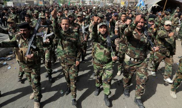 "Volunteers of the newly formed ""Peace Brigades"" participate in a parade in the Shiite stronghold of Sadr City, Baghdad, Iraq, Saturday, June 21, 2014. The armed group was formed after radical Shiite cleric Muqtatda al-Sadr called to form brigades to protect Shiite holy shrines against possible attacks by Sunni militants. (AP Photo/Khalid Mohammed)"