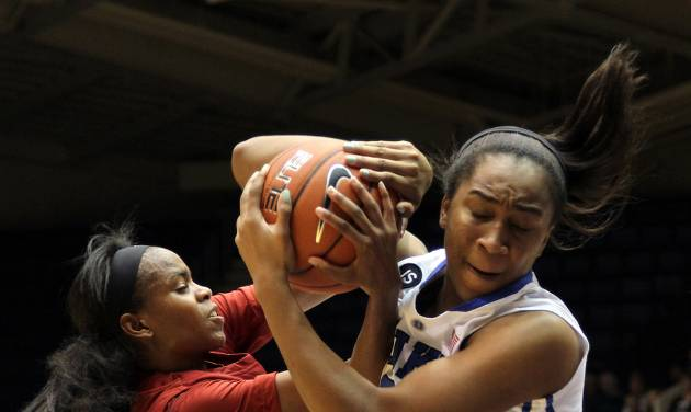 Duke's Oderah Chidom, right, fights for a rebound with Alabama's Daisha Simmons during the first half of an NCAA college basketball game in Durham, N.C., Sunday, Nov. 17, 2013.  Duke led at halftime 47-24.  (AP Photo/Ted Richardson)