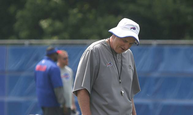 Buffalo Bills Coach Doug Marrone visits with player Kiko Alonso at the Bills OTA session today at the field house near Ralph Wilson Stadium in Orchard Park, N.Y., on  Tuesday, June 10, 2014.  (AP Photo/The Buffalo News, Robert Kirkham)   TV OUT; MAGS OUT; MANDATORY CREDIT; BATAVIA DAILY NEWS OUT; DUNKIRK OBSERVER OUT; JAMESTOWN POST-JOURNAL OUT; LOCKPORT UNION-SUN JOURNAL OUT; NIAGARA GAZETTE OUT; OLEAN TIMES-HERALD OUT; SALAMANCA PRESS OUT; TONAWANDA NEWS OUT