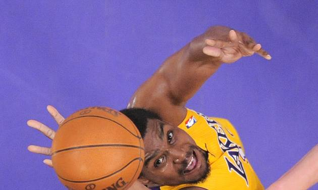 FILE - In this May 13, 2012 file photo, Los Angeles Lakers center Andrew Bynum puts up a shot during the first half in Game 7 in their first-round NBA basketball playoff series against the Denver Nuggets in Los Angeles. A person with knowledge of the negotiations says the Cleveland Cavaliers have offered free-agent center Andrew Bynum a two-year contract. The Cavs made the offer Monday night, July 8, 2013, a deal that includes a team option for the second year. The person who spoke to the Associated Press on Tuesday did so on condition of anonymity because of the sensitivity of the talks.  (AP Photo/Mark J. Terrill, File)