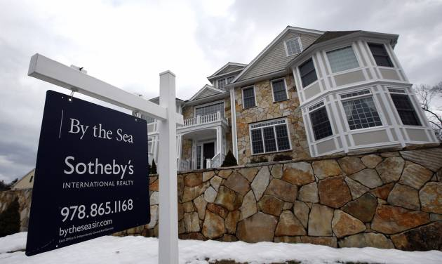 This March 21, 2014 photo shows a home for sale in North Andover, Mass. Freddie Mac, the mortgage company, releases weekly mortgage rates on Thursday, April 24, 2014. (AP Photo/Elise Amendola)