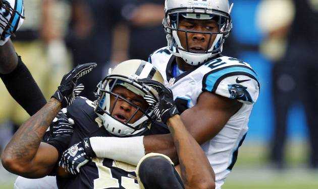 New Orleans Saints' Joe Morgan (13) reacts as he is hit by Carolina Panthers' Josh Norman (24) after a catch during the third quarter of an NFL football game in Charlotte, N.C., Sunday, Sept. 16, 2012. The pass was ruled incomplete. (AP Photo/Chuck Burton)