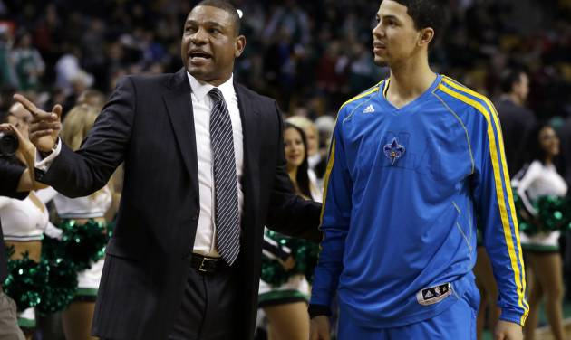 Boston Celtics head coach Doc Rivers, talks with his son, New Orleans Hornets shooting guard Austin Rivers, prior to an NBA basketball game in Boston, Wednesday, Jan. 16, 2013. (AP Photo/Elise Amendola)