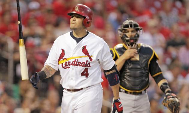 St. Louis Cardinals' Yadier Molina (4) tosses his bat in frustration after being called out on strikes as Pittsburgh Pirates catcher Russell Martin looks on in the fourth inning of a baseball game, Tuesday, July 8, 2014 in St. Louis. (AP Photo/Tom Gannam)