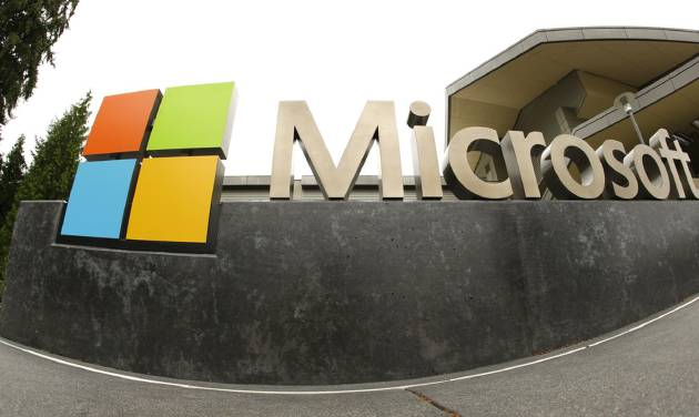 This photo taken July 3, 2014 shows the Microsoft Corp. logo outside the Microsoft Visitor Center in Redmond, Wash. Microsoft reports quarterly earnings on Tuesday, July 22, 2014. (AP Photo Ted S. Warren)