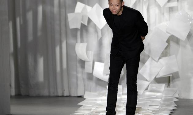 """FILE - In this Sept. 9, 2011 file photo, designer Jason Wu takes a bow after presenting his Spring 2012 collection during Fashion Week in New York. Wu may have won international recognition for twice designing inaugural gowns for U.S. first lady Michelle Obama, but judges in his native Taiwan seem unimpressed. Taiwan's Intellectual Property Court ruled Monday, Jan. 21, 2013 that Wu's new label """"Miss Wu"""" could not be registered as a brand because it was not distinctive enough. He designed Michelle Obama's white inaugural gown in 2008. On Monday, she appeared in another of his creations, a shiny gown with a red halter top. (AP Photo/Mary Altaffer, File)"""