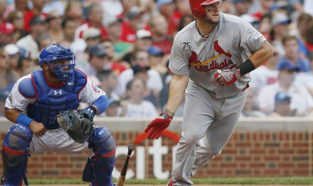 St. Louis Cardinals' Matt Adams watches his two-run triple against the Chicago Cubs during the seventh inning of a baseball game on Saturday, July 26, 2014, in Chicago. (AP Photo/Andrew A. Nelles)