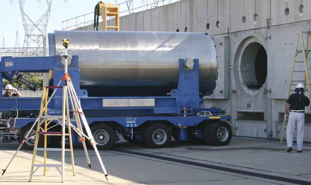In this June 15, 2012 photo released by Dominion Resources, a spent fuel storage container is offloaded from a trailer into a horizontal storage module at the Millstone Power Station in Waterford, Conn. With the collapse of a proposal for nuclear waste storage at Nevada's Yucca Mountain, Millstone and other plants across the country are building or expanding on-site storage for waste. (AP Photo/Dominion Resources)
