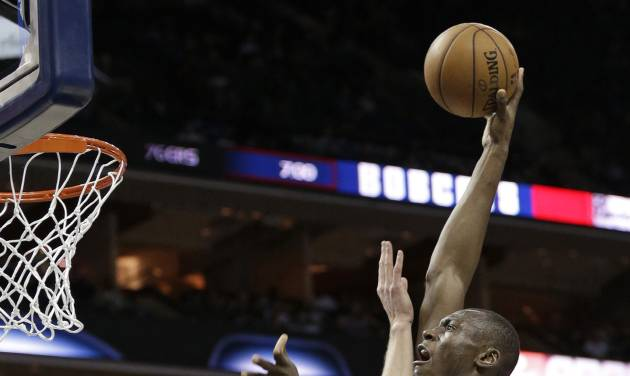 Charlotte Bobcats' Bismack Biyombo, right, shoots over Houston Rockets' Cole Aldrich, left, during the first half of an NBA basketball game in Charlotte, N.C., Monday, Jan. 21, 2013. (AP Photo/Chuck Burton)