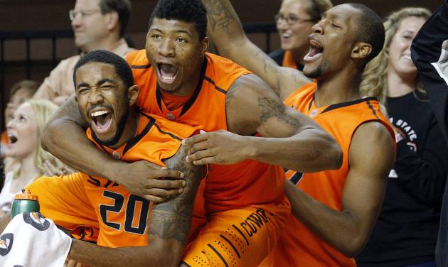 Oklahoma State's Michael Cobbins (20),  Marcus Smart (33) and Kamari Murphy (21) celebrate a three-pointer from Alex Budke (23) during the men's college basketball game between Oklahoma State University and Central Arkansas at Gallagher-Iba Arena in Stillwater, Okla., Sunday,Dec. 16, 2012. Photo by Sarah Phipps, The Oklahoman