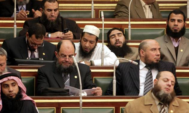 FILE - In this Monday, Jan. 23, 2012 file photo, Salafi lawmakers attend the first Egyptian parliament session after the revolution that ousted former President Hosni Mubarak, in Cairo, Egypt. Internal divisions are threatening to unravel Egypt's second biggest political party, the political arm of the ultraconservative Salafis, the country's most hardline Islamist movement.(AP Photo/Asmaa Waguih,Pool, File)