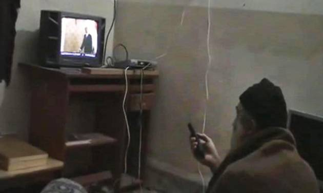 FILE - This undated image from video, seized from the walled compound of al-Qaida leader Osama bin Laden in Abbottabad, Pakistan, and released by the U.S. Department of Defense Saturday, May 7, 2011, shows a man, identified as Osama bin Laden, watching President Barack Obama on his television. Al-Qaida's image was a top concern on Osama bin Laden's mind in the last months of his life. In letters captured in the U.S. raid that killed him, the terror leader complains that al-Qaida branches kill too many Muslim civilians, turning the public against them. (AP Photo/Department of Defense, File)