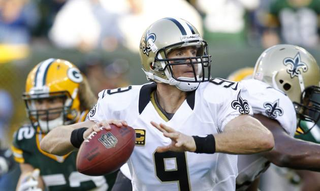 New Orleans Saints quarterback Drew Brees looks for a receiver during the second half of an NFL football game against the Green Bay Packers on Sunday, Sept. 30, 2012, in Green Bay, Wis. The Packers won 28-27. (AP Photo/Mike Roemer)
