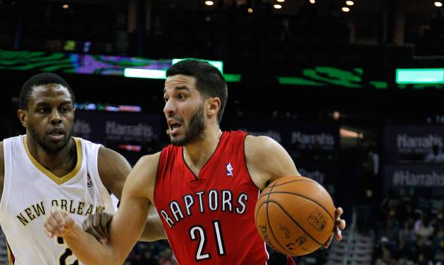 Toronto Raptors guard Greivis Vasquez (21) drives against New Orleans Pelicans forward Darius Miller (2) during the first half of an NBA basketball game in New Orleans, Wednesday, March 19, 2014. The Raptors won 107-100. (AP Photo/Jonathan Bachman)