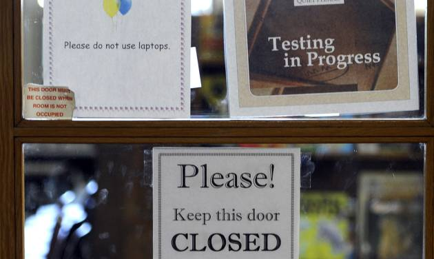 A sign on the door indicates ISTEP testing is going on in a classroom at Emmons Elementary School in Mishawaka, Ind. Wednesday May 1, 2013. Issues with the computer based testing program have caused some problems with the ISTEP test. The Indiana Department of Education said in a statement that administration of the ISTEP+ exams' online portion resumed Wednesday morning, but that schools are being asked to decrease their daily test load to 50 percent of normal levels until further notice.  (AP Photo/Joe Raymond)