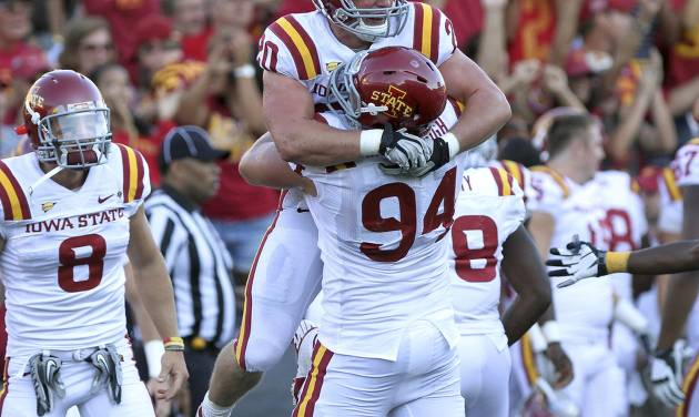 Iowa State's Jake McDonough (94) hugs Jake Knott after Knott intercepted an Iowa pass during the fourth quarter of an NCAA college football game Saturday, Sept. 8, 2012, in Iowa City, Iowa. Iowa State won 9-6. (AP Photo/Conrad Schmidt)
