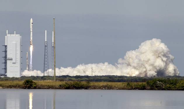 A United Launch Alliance Atlas V rocket, carrying an X-37B experimental robotic space plane, lifts off from launch complex 41 at the Cape Canaveral Air Force Station, Tuesday, Dec. 11, 2012, in Cape Canaveral, Fla. Air Force officials said the unmanned space plane, which resembles a miniature space shuttle, provides a way to test technologies in space.(AP Photo/John Raoux)