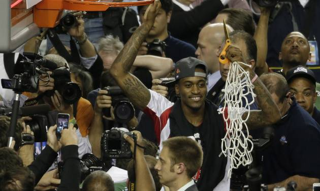Louisville guard Kevin Ware holds the net after Louisville defeated Michigan 82-76 after the second half of the NCAA Final Four tournament college basketball championship game Tuesday, April 9, 2013, in Atlanta. (AP Photo/Chris O'Meara)  ORG XMIT: FF314