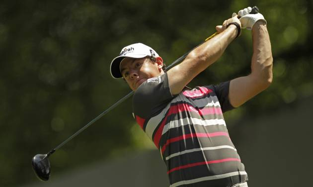 Rory McIlroy, of Northern Ireland, watches his tee shot on the fourth hole during the pro-am of the Wells Fargo Championship golf tournament at Quail Hollow Club in Charlotte, N.C., Wednesday, May 2, 2012. (AP Photo/Chuck Burton)