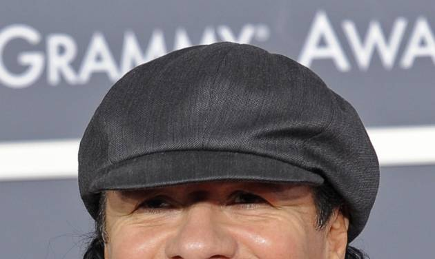 """FILE - In this Jan. 31, 2010 file photo, musician Carlos Santana arrives at the Grammy Awards in Los Angeles. The Grammy-winning superstar has an agreement with Little, Brown and Co. to tell his life story. The publisher, a division of Hachette Book Group, announced Thursday, Sept. 13, 2012, that the book is scheduled for release in 2014. It doesn't yet have a title. The 65-year-old Santana is expected to tell stories of such friends and peers as Miles Davis, Eric Clapton and Herbie Hancock. Little, Brown and Co. has a strong history of rock star memoirs: Two years ago, it published Keith Richard's """"Life."""" Santana has won 15 Grammys and is best known for the album """"Supernatural,"""" which has sold more than 25 million copies. (AP Photo/Chris Pizzello, file)"""