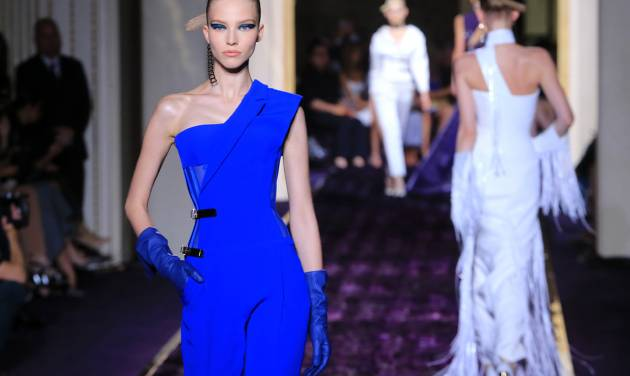 Models present creations by Italian fashion designer Donatella Versace, as part of the Atelier Versace Fall Winter 2014-15 Haute Couture fashion collection, Sunday, July 6, 2014, in Paris. (AP Photo/Jacques Brinon)