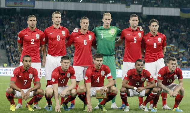 FILE - In this Sept. 10, 2013 file photo, England national soccer team poses prior to the World Cup qualifier group H soccer match between Ukraine and England at the Olympiyskiy national stadium in Kiev, Ukraine. Background from left: Kyle Walker, Rickie Lambert, Phil Jagielka, Joe Hart, Gary Cahill and Frank Lampard. Foreground from left: Theo Walcott, James Milner, Steven Gerrard, Ashley Cole and Jack Wilshere. The draw for the 2014 World Cup finals takes place Friday Dec. 6, 2013 near Salvador, Brazil. The 32 teams will be drawn into eight groups of four. The top two in each group will progress to the knockout stages. Twelve stadiums in twelve cities will host matches. (AP Photo/Efrem Lukatsky, File)