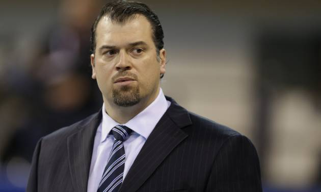 FILE - In this Dec. 15, 2013, file photo, Indianapolis Colts general manager Ryan Grigson watches warm-ups before an NFL football game against the Houston Texans in Indianapolis. The Colts are projected to be about $31 million under the salary cap heading into this offseason, and Grigson is looking to plug more holes on his team. (AP Photo/Darron Cummings, file)