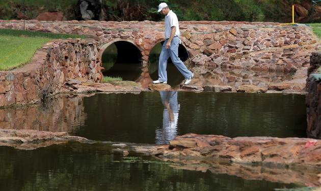 Bob Tway crosses the bridge from the fourth green to the fifth tee during practice rounds for the U.S. Senior Open golf tournament at Oak Tree National in Edmond, Okla. on Wednesday, July 9, 2014. PHOTO BY CHRIS LANDSBERGER, The Oklahoman