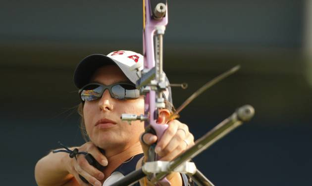 """FILE - This Aug. 12, 2008 file photo shows Jennifer Nichols shooting an arrow during the elimination round of women's individual archery at the Beijing 2008 Olympics in Beijing. Nichols' eyes light up with she talks about her sport finally climbing out of the shadows. """"The Hunger Games"""" has shined a bright light on the ancient sport of archery and fueled interest across the country to pick up a bow and arrow. (AP Photo/Saurabh Das, File )"""
