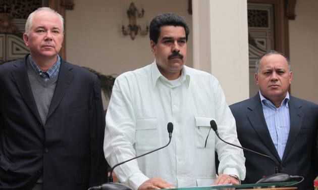 "In this photo released by Miraflores Press Office, Venezuela's Vice President Nicolas Maduro, center, addresses the nation on live television flanked by Oil Minister Rafael Ramirez, left, and National Assembly President Diosdado Cabello at the Miraflores presidential palace in Caracas, Venezuela, Wednesday, Dec. 12, 2012.  Maduro said that Venezuela's President Hugo Chavez will face a ""complex and hard"" process after undergoing his fourth cancer-related operation in Cuba on Tuesday. Over the weekend, Chavez named Maduro as his chosen political heir. (AP Photo/Miraflores Press Office, Efrain Gonzalez)"
