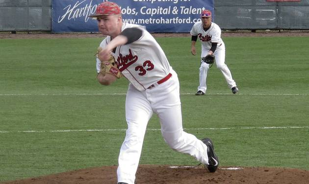 In this photo made Saturday, March 29, 2014, University of Hartford pitcher Sean Newcomb delivers during a baseball game against Stony Brook in Hartford, Conn.  The 6-foot-5 left hander is considered a top major-league prospect. (AP Photo/Pat Eaton-Robb)