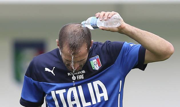 Italy defender Giorgio Chiellini drops water as he refreshes during a training session of Italy in Mangaratiba, Brazil, Saturday, June 7, 2014. Italy play in group D of the 2014 soccer World Cup. (AP Photo/Antonio Calanni)