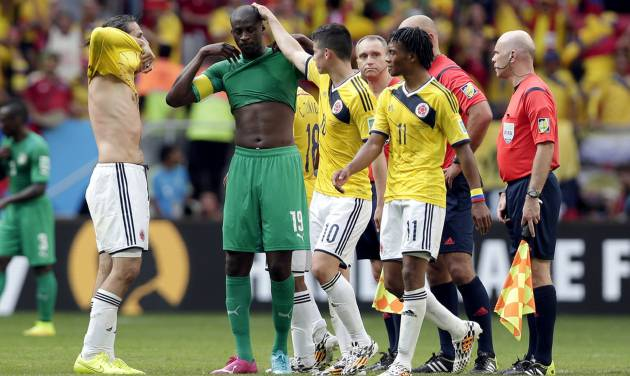 Colombia players console Ivory Coast's Yaya Toure after the group C World Cup soccer match between Colombia and Ivory Coast at the Estadio Nacional in Brasilia, Brazil, Thursday, June 19, 2014.  Colombia won the match 2-1.  (AP Photo/Marcio Jose Sanchez)