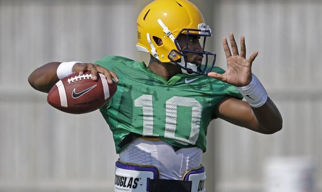 LSU quarterback Anthony Jennings (10) passes during their NCAA college football practice in Baton Rouge, La., Wednesday, Aug. 6, 2014. (AP Photo/Gerald Herbert)