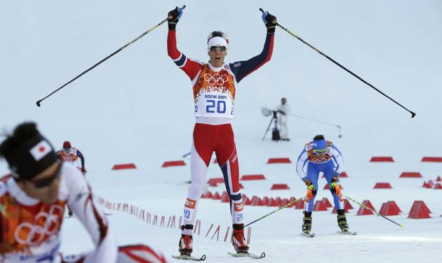 Norway's Magnus Krog crosses the finish line to win the bronze during the cross-country portion of the Nordic combined at the 2014 Winter Olympics, Wednesday, Feb. 12, 2014, in Krasnaya Polyana, Russia. (AP Photo/Matthias Schrader)