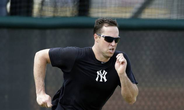 FILE - In this May 6, 2013, file photo, New York Yankees first baseman Mark Teixeira runs sprints during a rehab workout at the Yankees' Minor League Complex in Tampa, Fla. Teixeira started baseball workouts on Sunday, Feb. 16, 2014, four days ahead of the other position players. (AP Photo/Chris O'Meara, File)