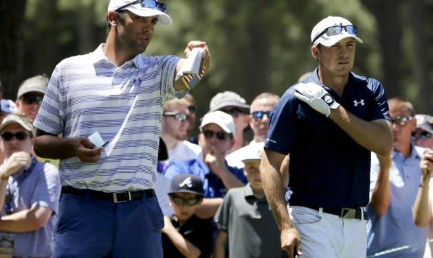 Jordan Spieth, right, and caddie Michael Greller talk on the 16th tee during a practice round for the U.S. Open golf tournament in Pinehurst, N.C., Tuesday, June 10, 2014. The tournament starts Thursday. (AP Photo/Chuck Burton)