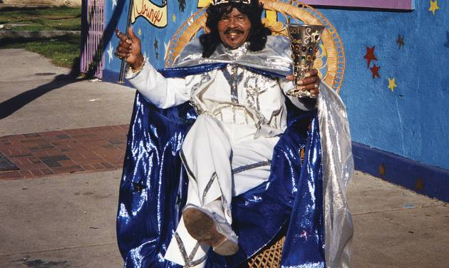 """In this 2001 image released by The Historic New Orleans Collection, Ernie K-Doe poses outside of his Mother-In-Law Lounge during Jazz Fest in New Orleans. A new book published by the Historic New Orleans Collection, """"Enie K-Doe: The R&B Emperor of New Orleans,"""" by Ben Sandmel, captures the quirks and talent of one of New Orleans' most celebrated and eccentric entertainers, his ups and downs and the era that shaped him. (AP Photo/The Historic New Orleans Collection, Pat Jolly)"""