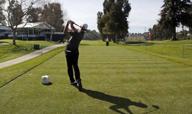 Defending champion John Merrick hits from the 15th tee during the pro-am of the Northern Trust Open golf tournament at Riviera Country Club in the Pacific Palisades area of Los Angeles on Wednesday, Feb. 12, 2014.  (AP Photo/Reed Saxon)