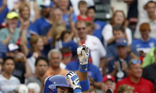 Chicago Cubs' Luis Valbuena, right, celebrates his home run off St. Louis Cardinals relief pitcher Kevin Siegrist during the seventh inning of a baseball game Friday, July 25, 2014, in Chicago. (AP Photo/Charles Rex Arbogast)