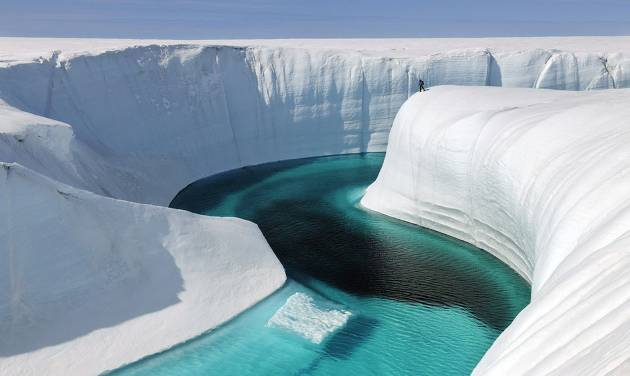 "This 2009 photo released by Extreme Ice Survey shows Birthday Canyon in Greenland furing the filming of ""Chasing Ice."" The film, about climate change, follows National Geographic photographer James Balog across the Arctic as he deploys revolutionary time-lapse cameras designed to capture a multi-year record of the world's changing glaciers. (AP Photo/Extreme Ice Survey, James Balog)"