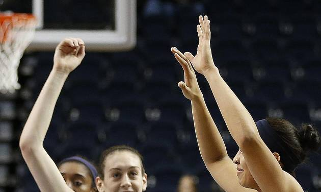 Connecticut forward Breanna Stewart, left, waves to fans during practice before the women's Final Four of the NCAA college basketball tournament, Saturday, April 5, 2014, in Nashville, Tenn. Connecticut plays Stanford Sunday. (AP Photo/Mark Humphrey)